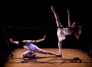 two dancers at a barre